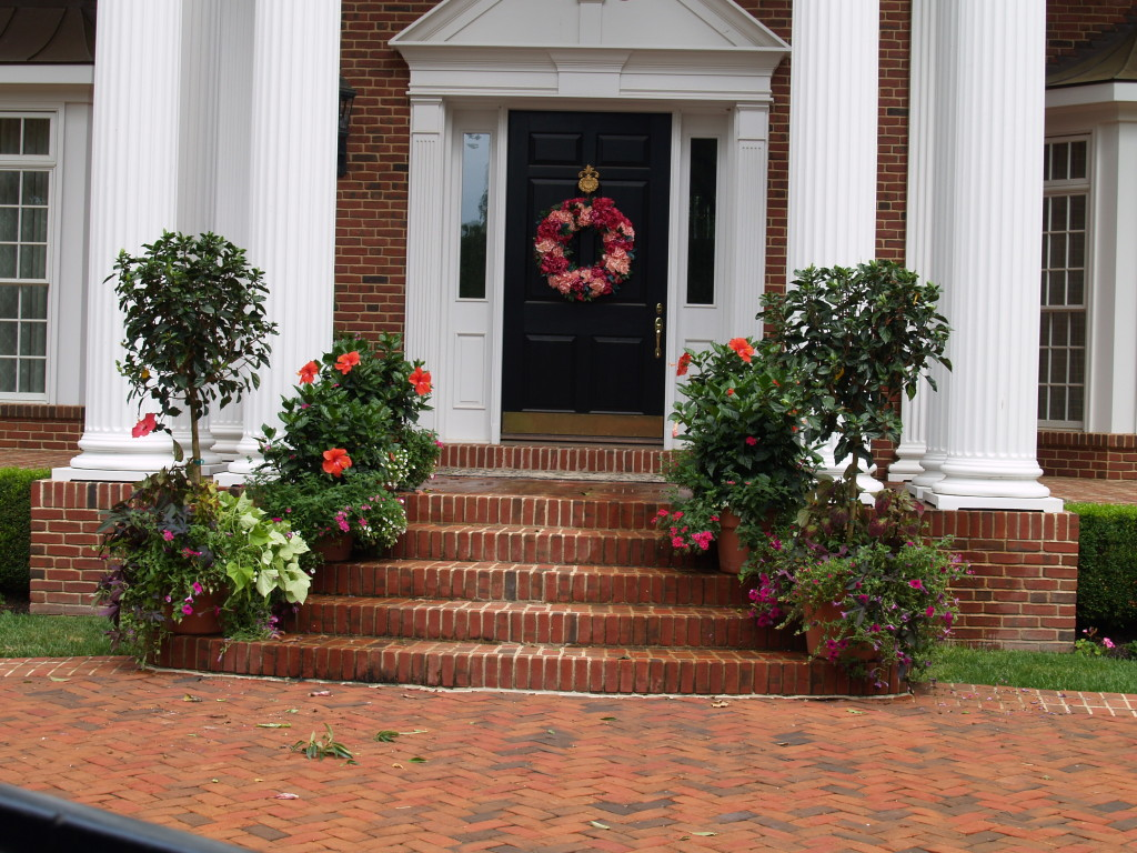 Frame a doorway with attractive container gardens to create an inviting entry for visitors.